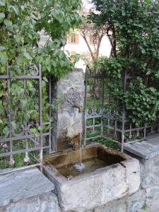 This type of decorative fountain is a common fixture all around Italy.  It is the equivalent of our drinking fountains.  I still can't wrap my head around that!