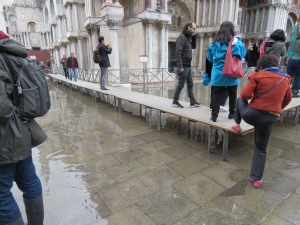 Venice has a flooding problem during high tide!  Unfortunately, San Marcos Square gets the brunt of it!  They have these risers so people can walk without getting soaked!